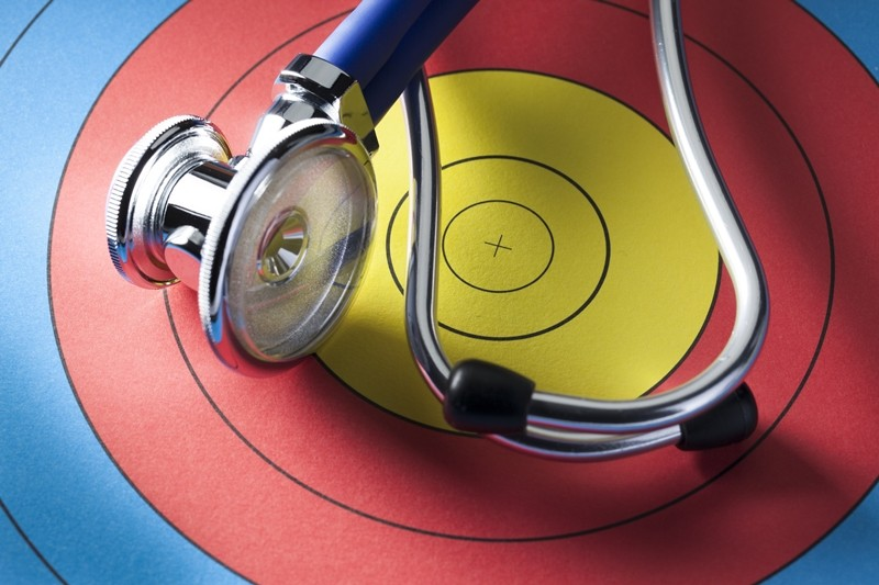 stethoscope placed on a colorful  target